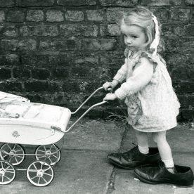 Girl with pram Shirley Baker