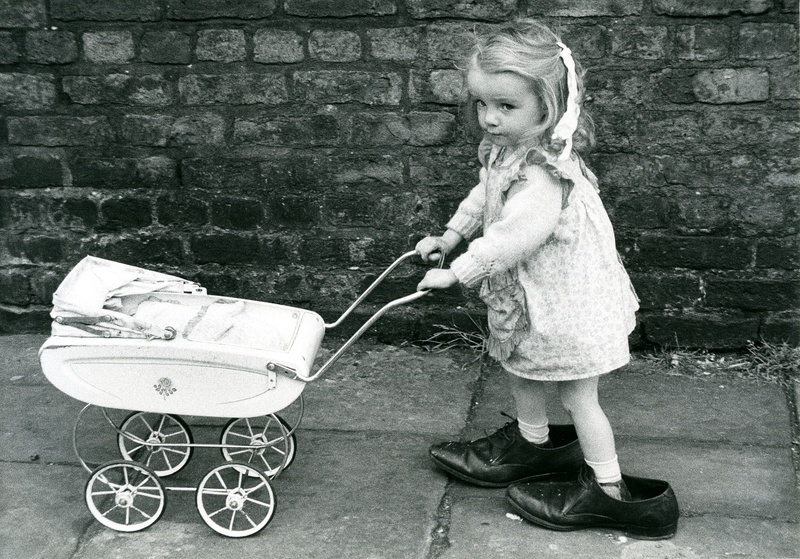 Girl with pram Shirley Baker